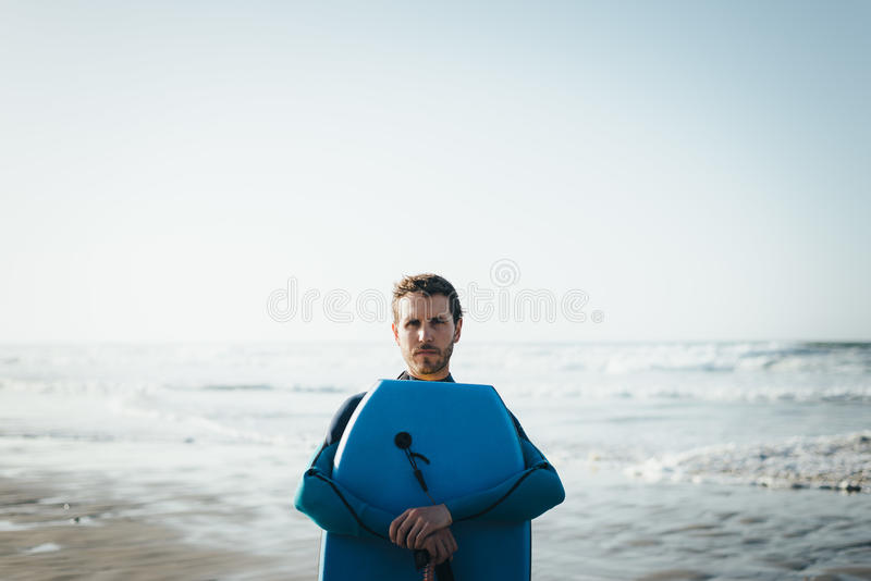 Man portrait with bodyboard after surfing royalty free stock image