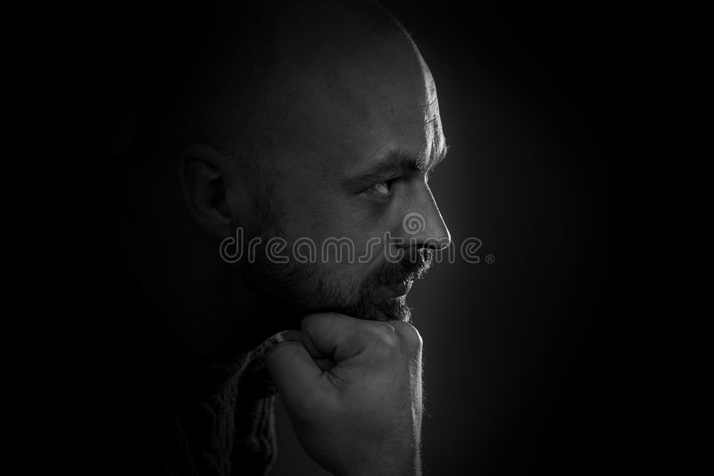 Man portrait in dark stock image