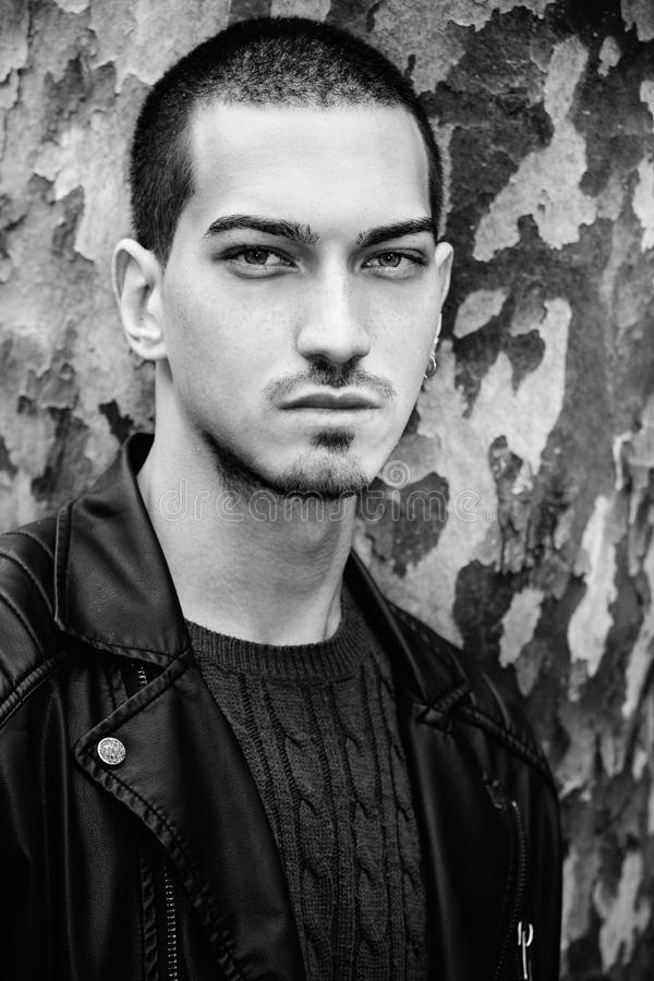 Man portrait outdoors. Handsome natural male. Black and white stock photos