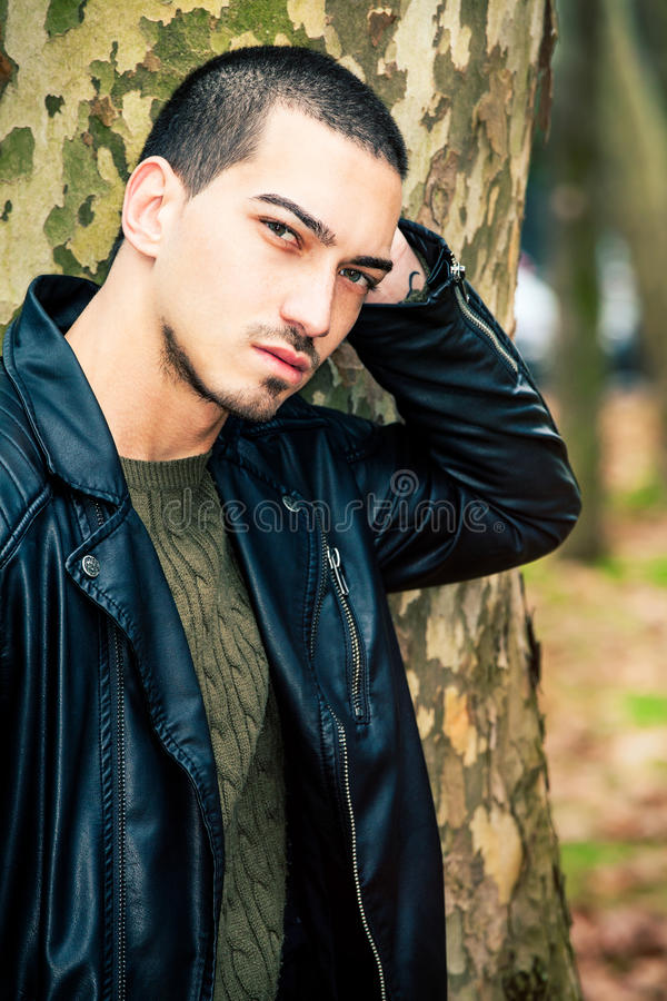 Man portrait outdoors. Handsome natural male stock photography