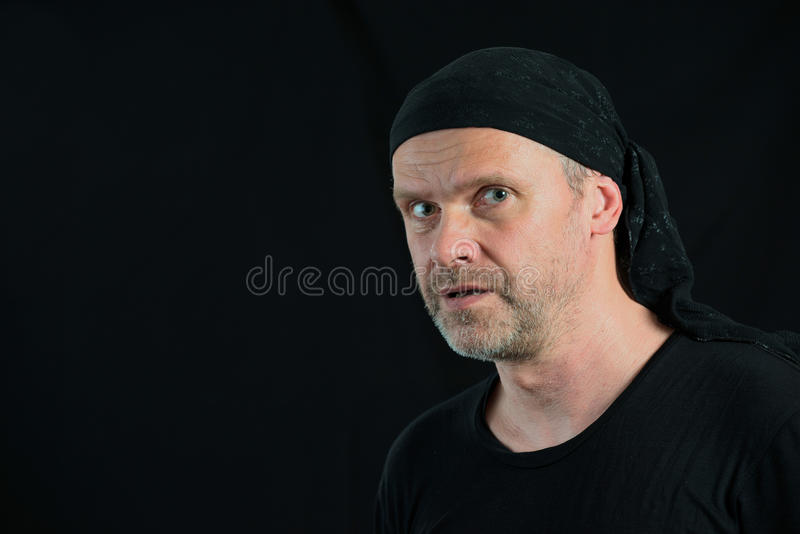 Man portrait 50 years old on black royalty free stock photography
