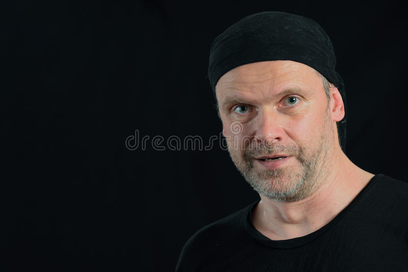 Man portrait 50 years old on black royalty free stock images