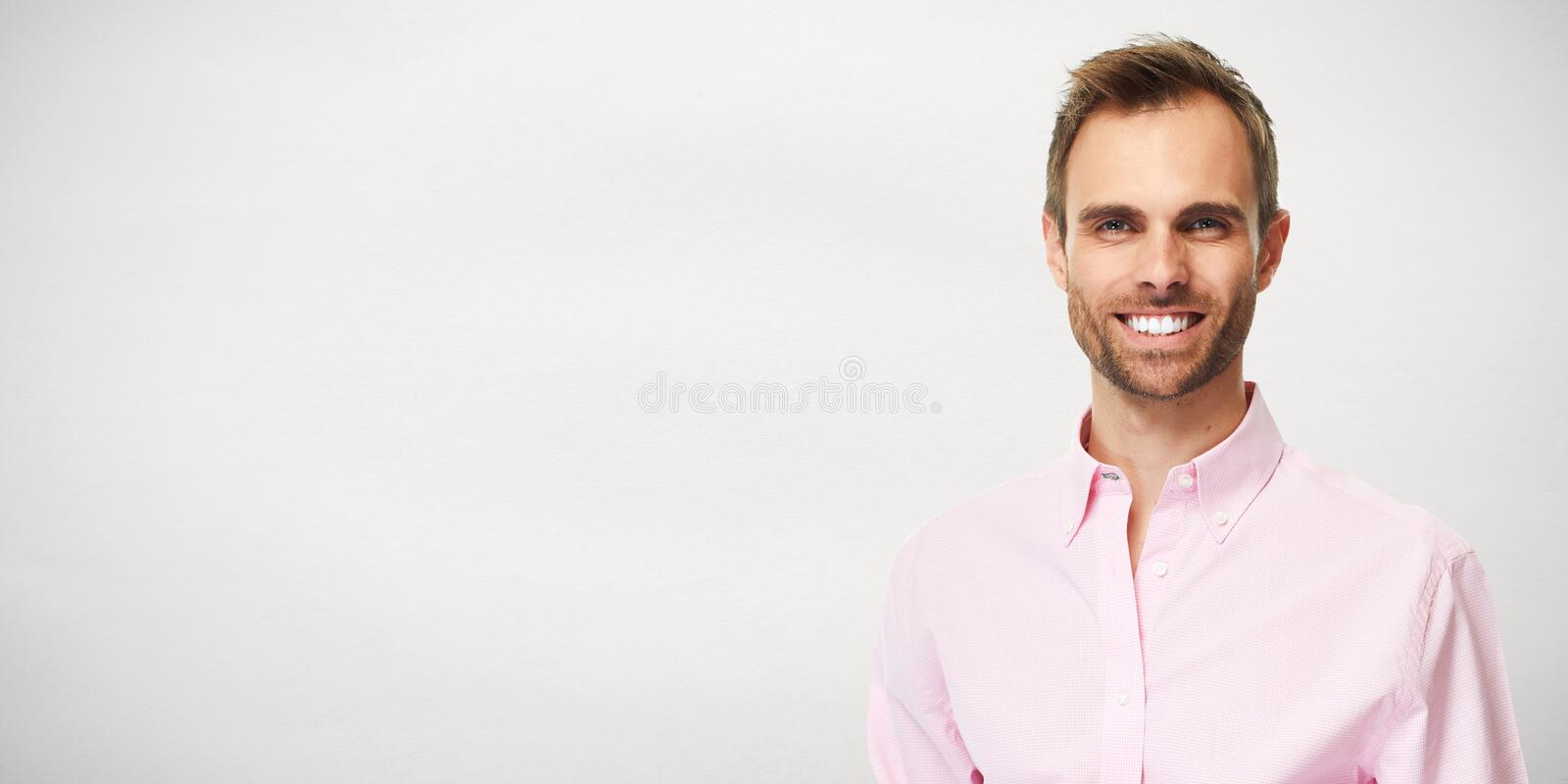 Man portrait. Young handsome casual man portrait over gray background royalty free stock images