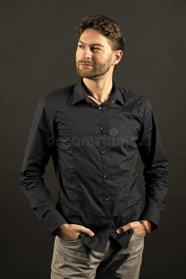 Man pose in fashionable shirt and jeans, fashion. Guy with bearded face and stylish hair, haircut. Mens fashion, style. And trend. Grooming and hair care in stock image
