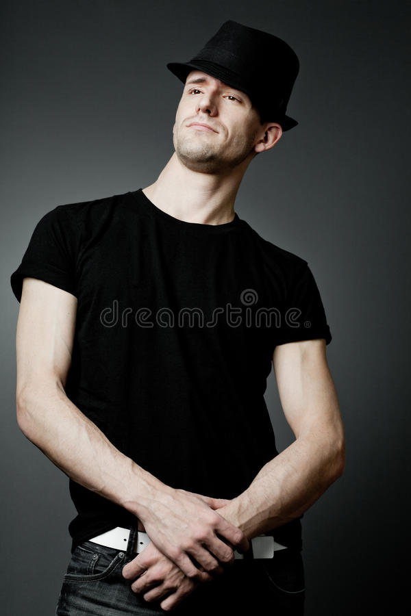 Download Man Posing In Black T-shirt And Black Hat. Stock Photo - Image: 23632046