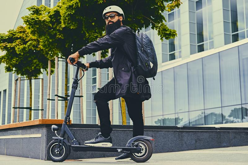 A man posing on electric scooter. royalty free stock photography
