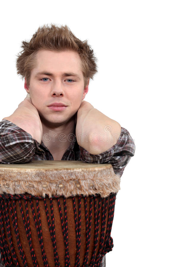 Download Man posing with his djembe stock image. Image of elbows - 28010439