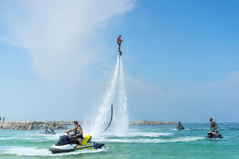 Man posing at new flyboard at Caribbean tropical beach. Positive human emotions, feelings, joy. Funny cute men making vacations an royalty free stock photography