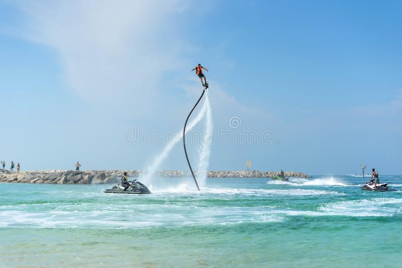 Man posing at new flyboard at Caribbean tropical beach. Positive human emotions, feelings, joy. Funny cute men making vacations an stock images