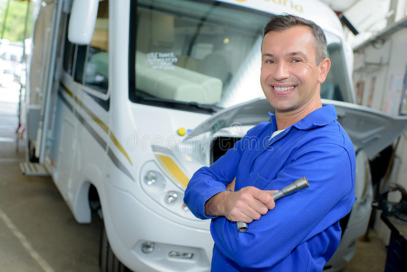 Man posing with rv. Man posing with an rv stock images
