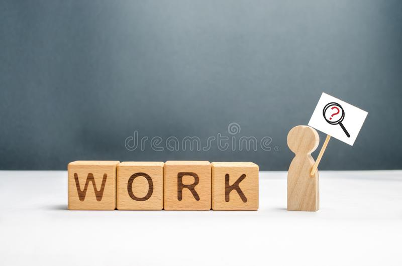 Man with a poster and a magnifying glass near the cubes with the word work. Man in search of work or part-time job. Headhunters stock images