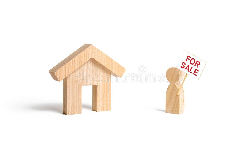 A man with a poster for sale stands near the house on an isolated background. concept of selling a home, buying from the owner. royalty free stock photo