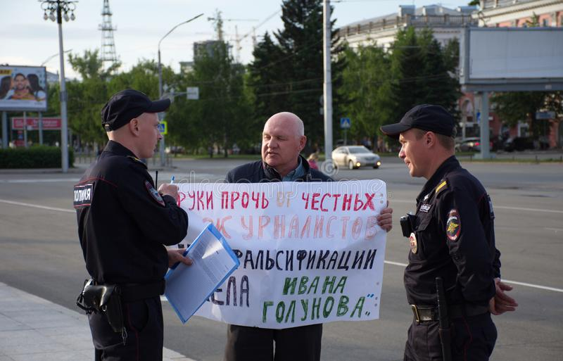A man with a poster in support of correspondent Ivan Golunov and honest journalists detained by polic. Barnaul,Russia-July 9, 2019. A man with a poster in royalty free stock photography