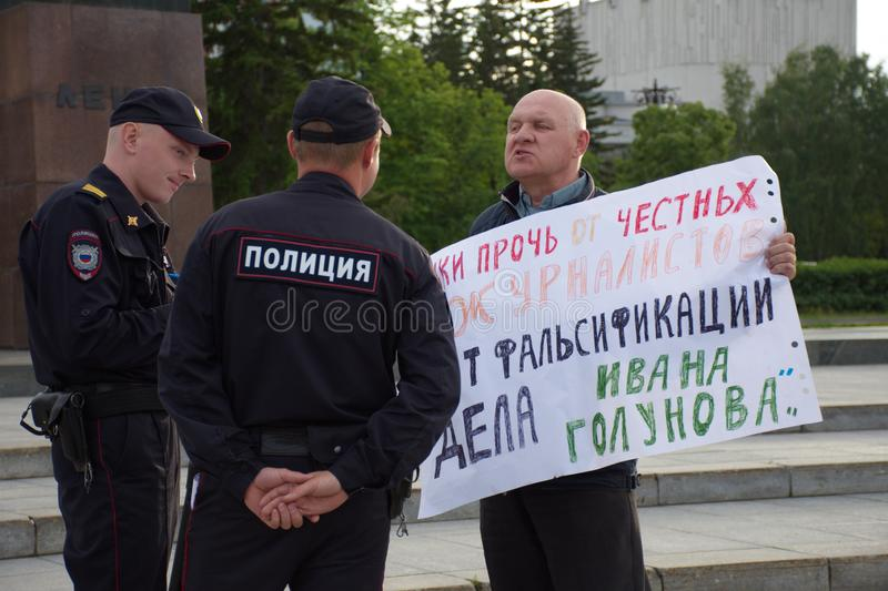 A man with a poster in support of correspondent Ivan Golunov and honest journalists detained by polic. Barnaul,Russia-July 9, 2019. A man with a poster in royalty free stock photos