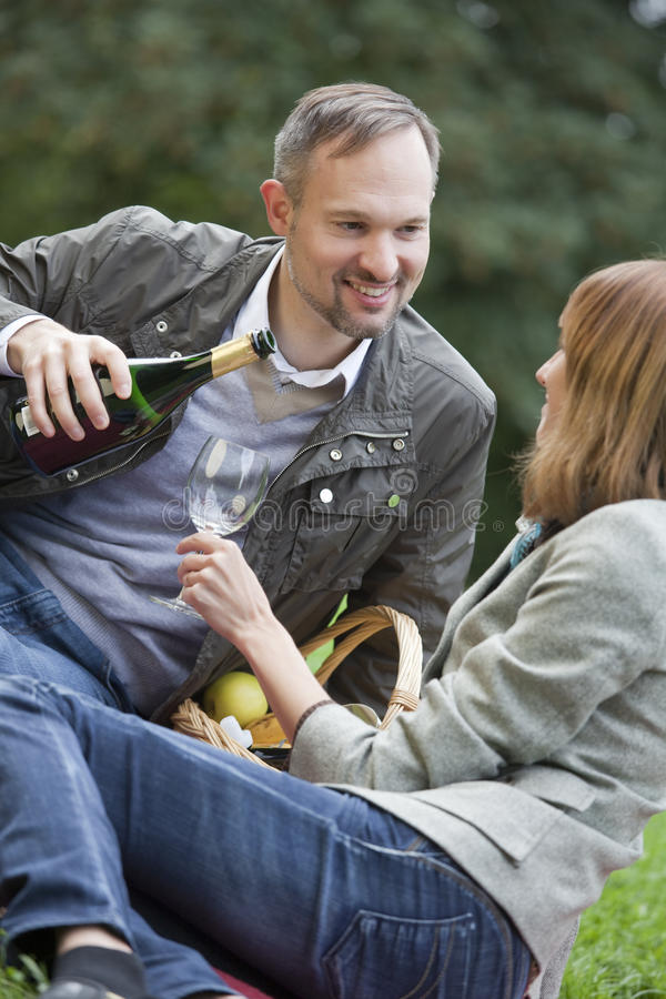 Download Man Pouring Champagne Into A Glass Stock Photo - Image: 10823250