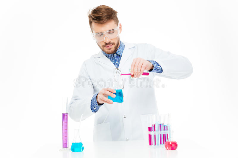 Man pouring chemicals royalty free stock photography