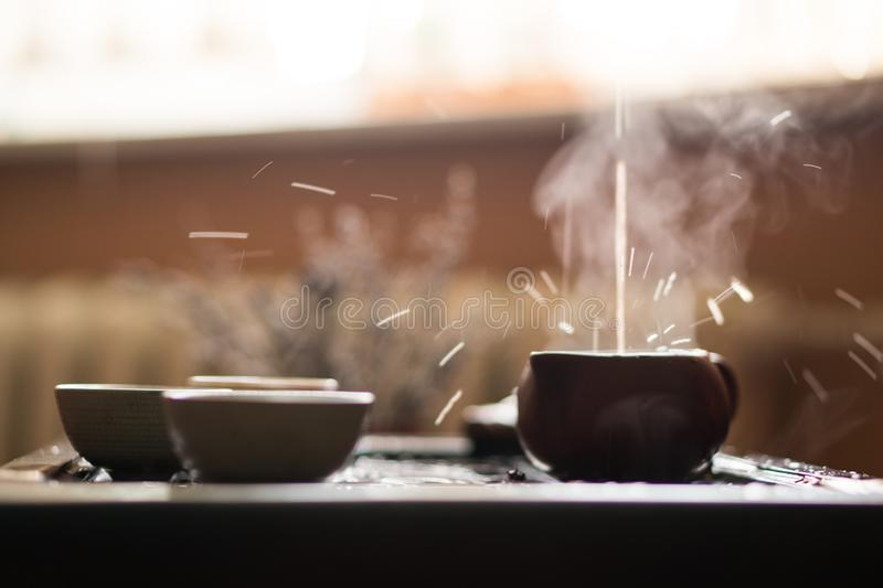 Pouring of Puer Tea from Teapot at Traditional Chinese Tea Ceremony. Set of Equipment for Drinking Tea. Man Pouring Puer Tea from Teapot at Traditional Chinese royalty free stock photos