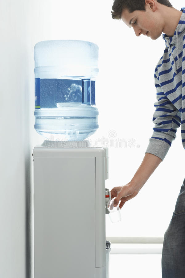 Man Pouring Water From Cooler royalty free stock image