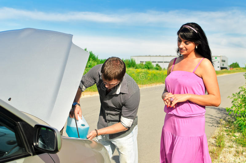 Download Man Pours A Liquid To The Car Stock Photo - Image of male, auto: 25405518