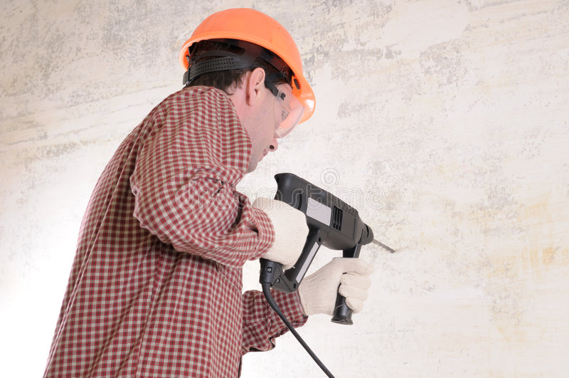 Man with power drill royalty free stock image