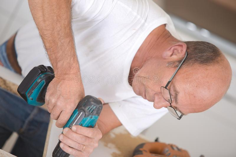Man with power tool. Adult royalty free stock image