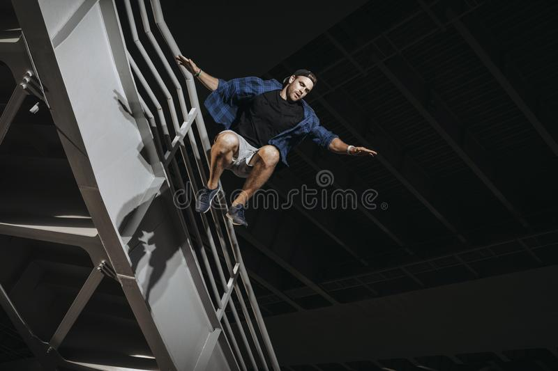 Man practicing parkour. Doing huge scary jumps. Free running athlete training stock images