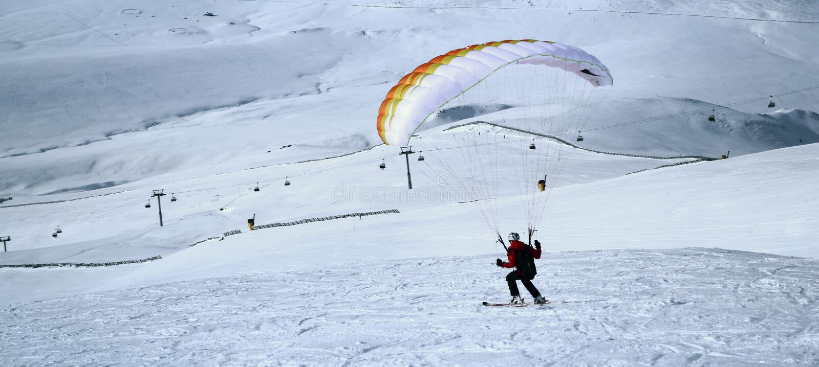 Speedflying. Man practicing speedflying at 2000 m altitude, in Sinaia, Romania royalty free stock images