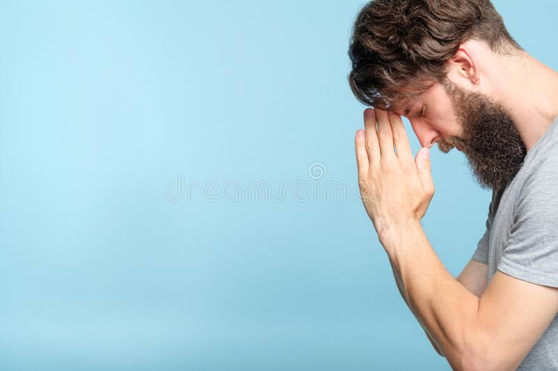 Man pray hands forehead spirituality faith belief royalty free stock photo