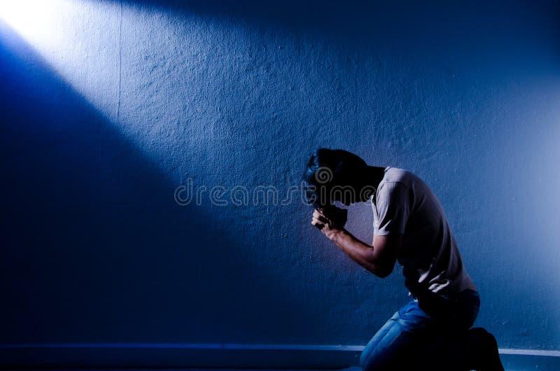 Man praying. One man praying in the room