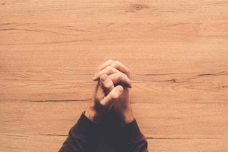 Man praying, overhead view royalty free stock photography