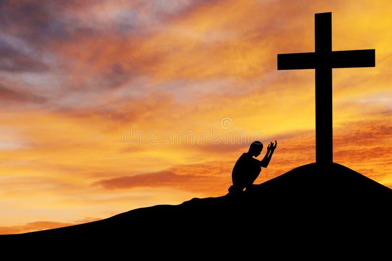 Man praying under the cross stock photography