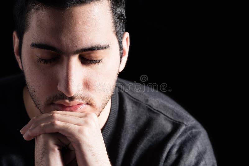 Man Praying. Young Man at Peace Praying royalty free stock image