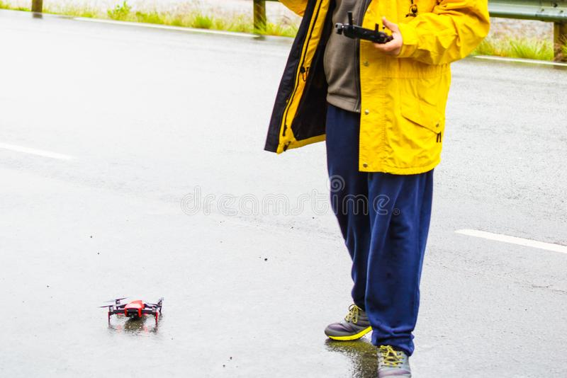 Man preparation drone to start flying stock photos