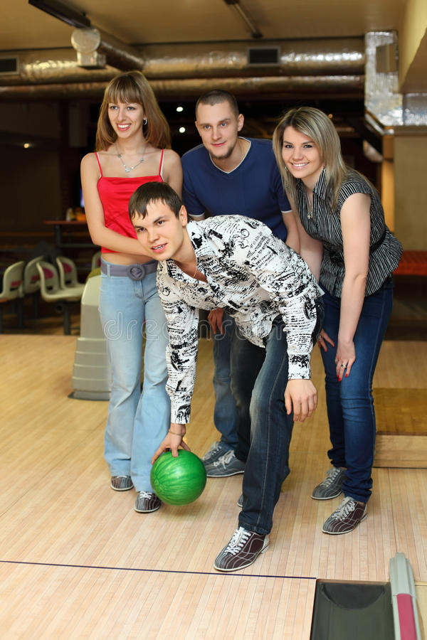 Download Man Prepares Throw Ball In Bowling Club Stock Photo - Image: 20698830