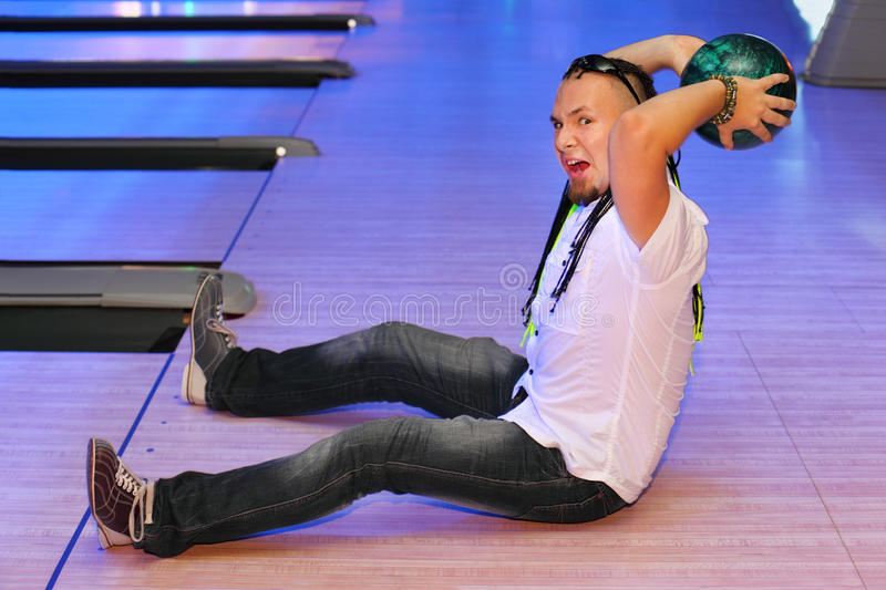 Man Prepares To Throw In Bowling Club Stock Image