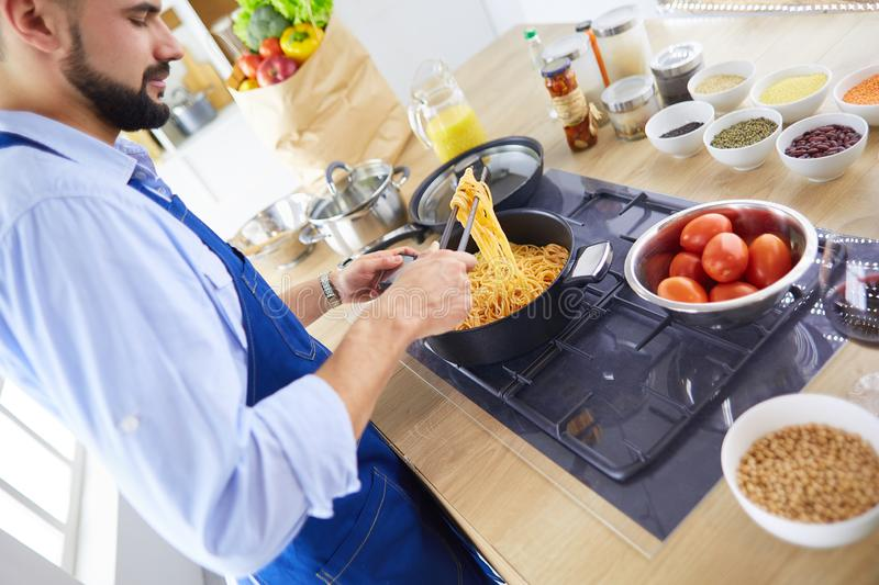 Man preparing delicious and healthy food in the home kitchen stock image