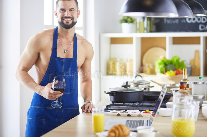 Man preparing delicious and healthy food in the home kitchen royalty free stock photography