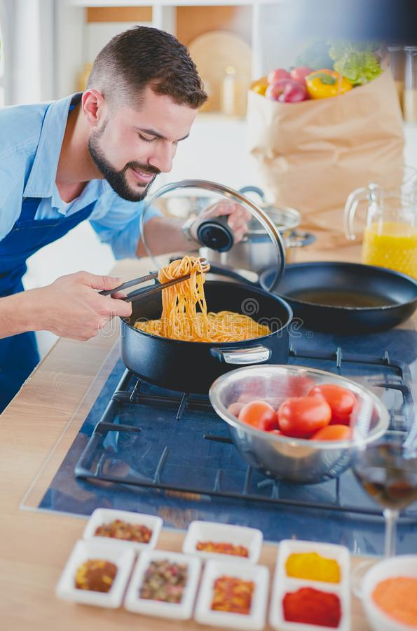 Man preparing delicious and healthy food in the home kitchen stock photos