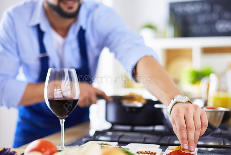 Man preparing delicious and healthy food in the home kitchen royalty free stock photo