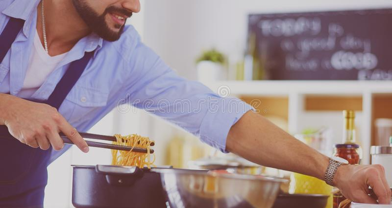 Man preparing delicious and healthy food in the home kitchen stock photography