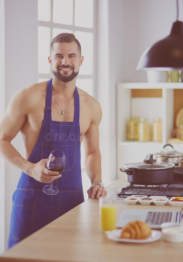 Man preparing delicious and healthy food in the home kitchen royalty free stock photos