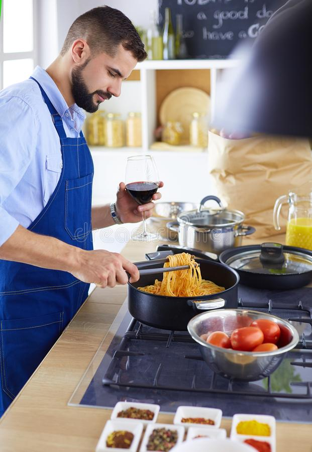 Man preparing delicious and healthy food in the home kitchen royalty free stock image