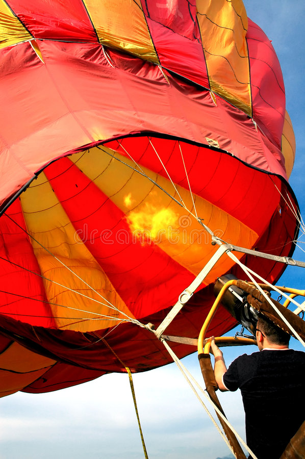 Man preparing hot air baloon for fly #4 royalty free stock photography