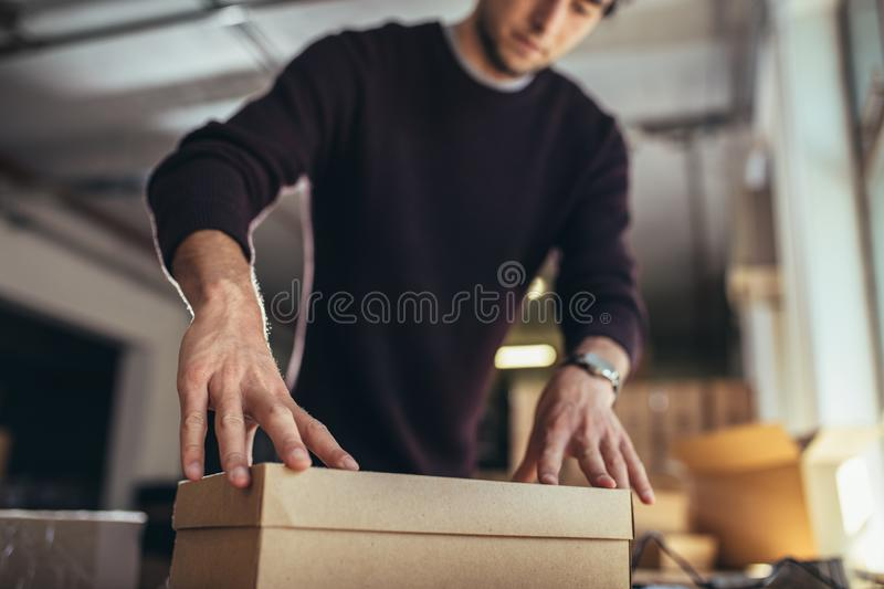 Man preparing a shipment as ordered stock image