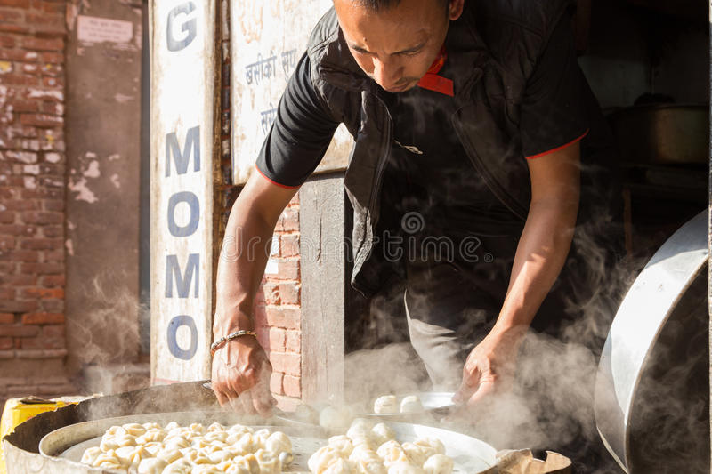 Man preparing steamed Momos, Nepal royalty free stock photography