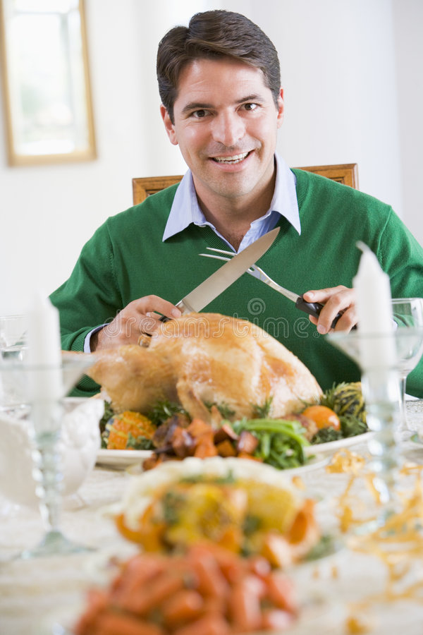 Man Preparing To Carve A Turkey royalty free stock images