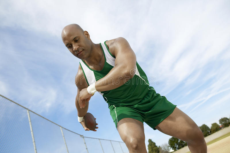 Download Man Preparing To Throw Discus Stock Photo - Image: 29654910