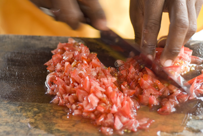 Man preparing tomatoes for ceviche