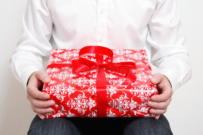 Man with present. A man with a christmas present royalty free stock image