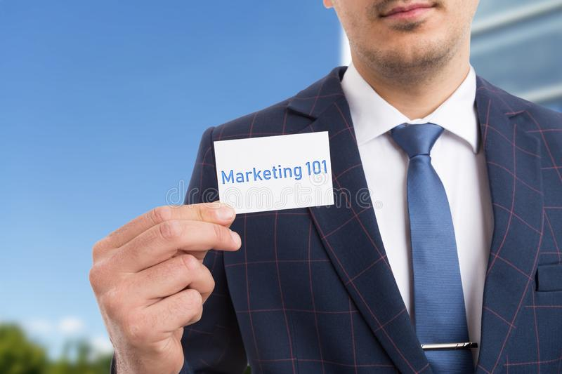 Man presenting marketing one-hundred and one card. Man presenting marketing one-hundred and one by holding card in hand as must-know information concept royalty free stock images